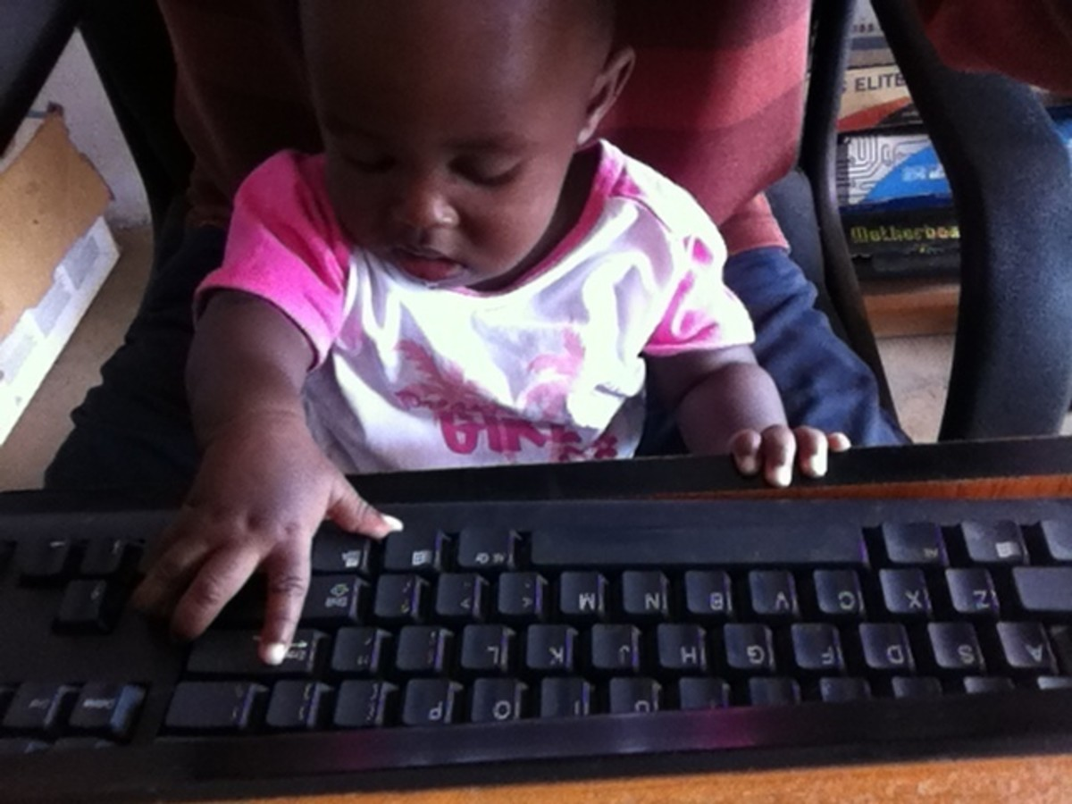 A baby using a computer is one cute example of humanware.