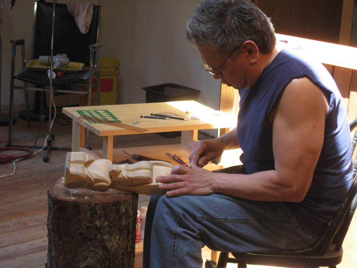 Rupert Scow patiently teaching us to carve a small totem pole