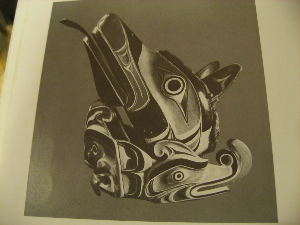 Old headress with sea serpent and bear.  Willie Seaweed carves the sea serpent.