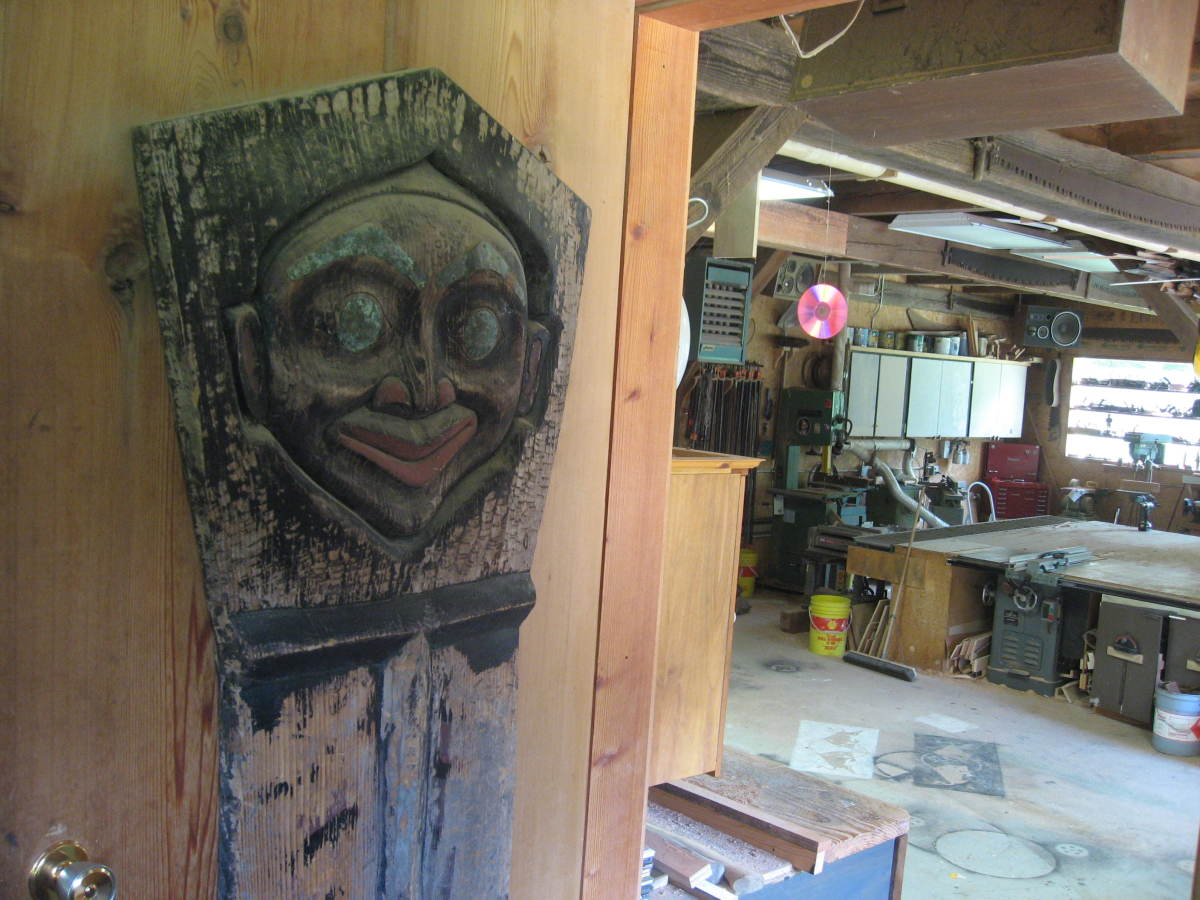 Entering Andrews downstairs workshop-carvings, power tools, storage areas
