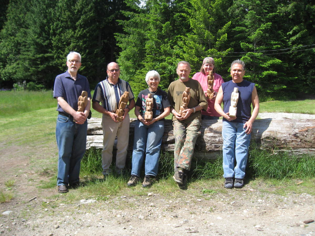 The happy carvers on day five. We have still not finished our small totem poles.