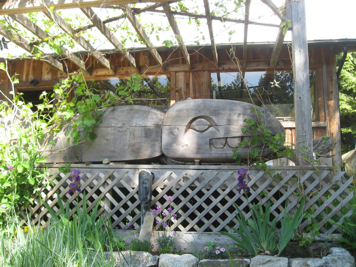 Detail from porch of Andrew's carving workshop on his property in the Robert's Creek woods.