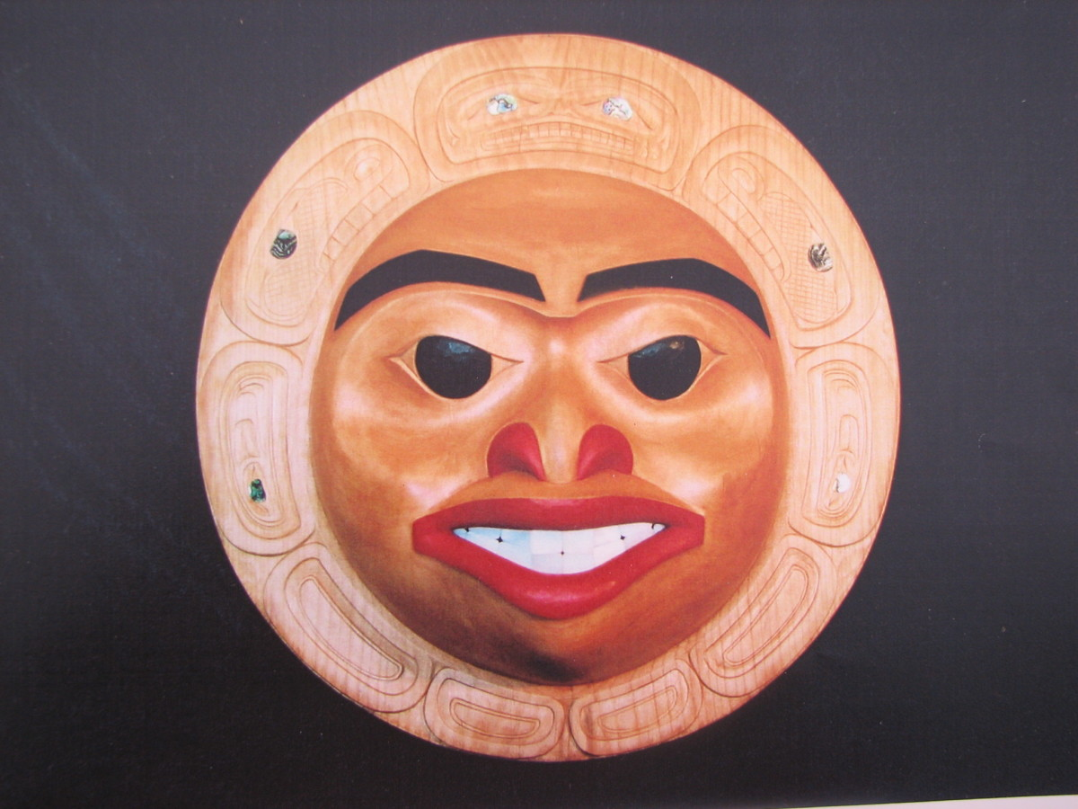 Moon Mask-Gitxsan Wetsuweten style carving. Note the flatter flowing planes and the sparser painting using mainly black and red accent colors with carved formline design and inlay.