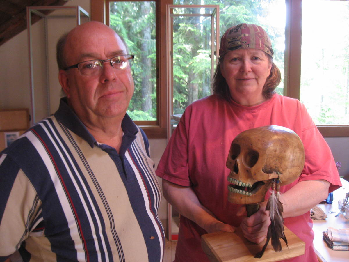 Hugh and Karen discuss the anatomical accuracy of a carved scull rattle.