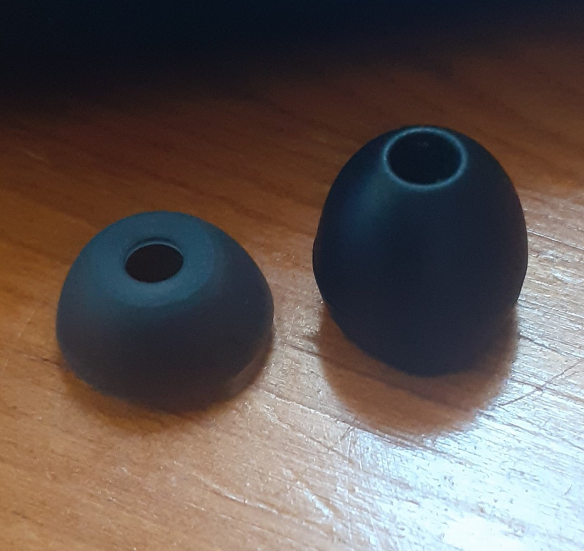 Original silicone tips on the left.