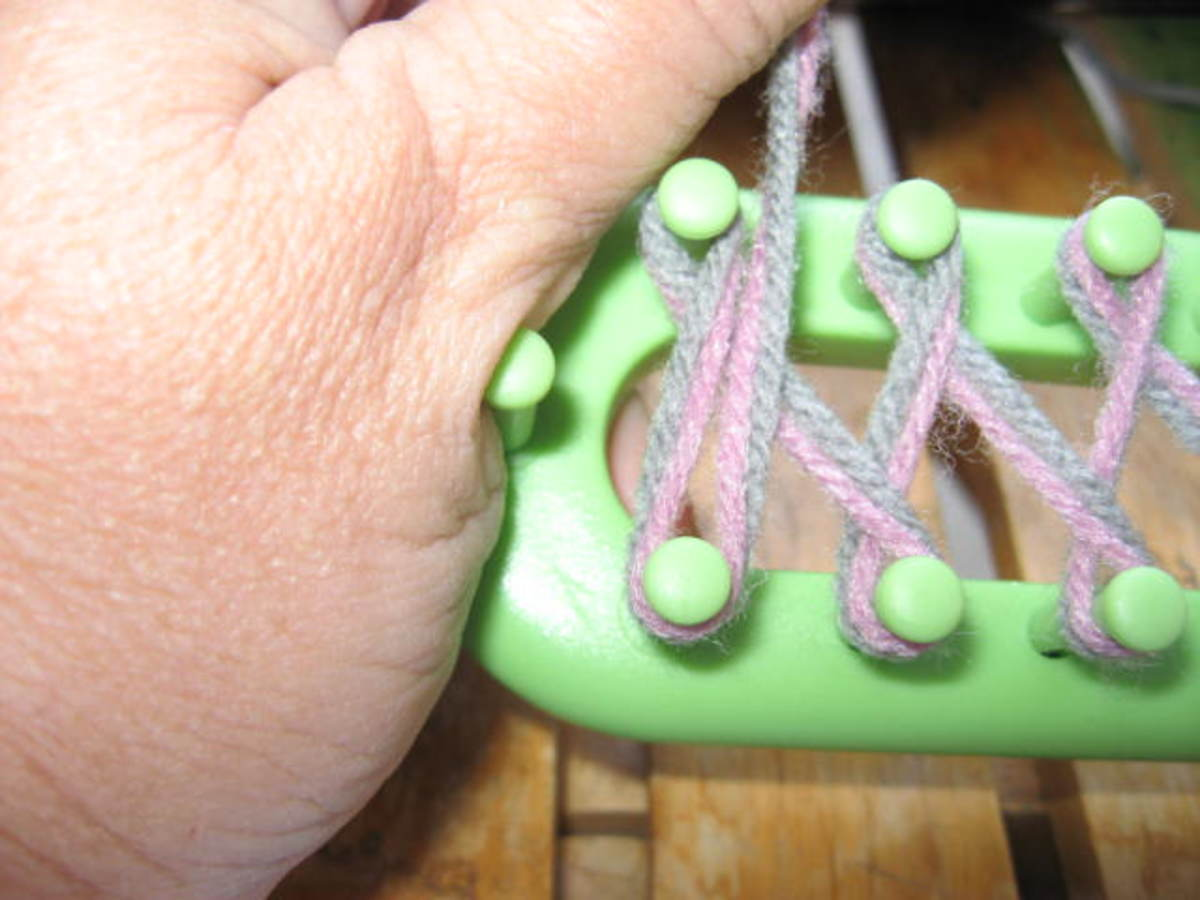 When you get to the end, turn loom around, and wrap pegs as shown. Then pull yarn straight across and hold for a moment.