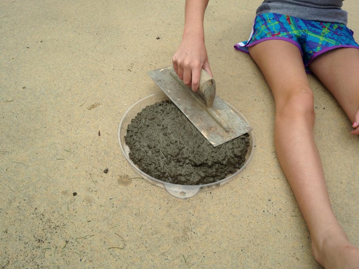 Smooth concrete into mold
