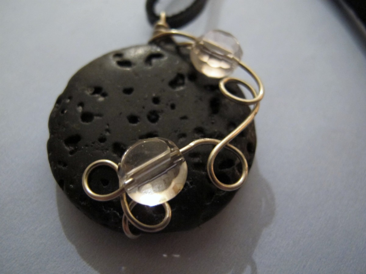 Lava stone with silver wire wrap and pink crystals