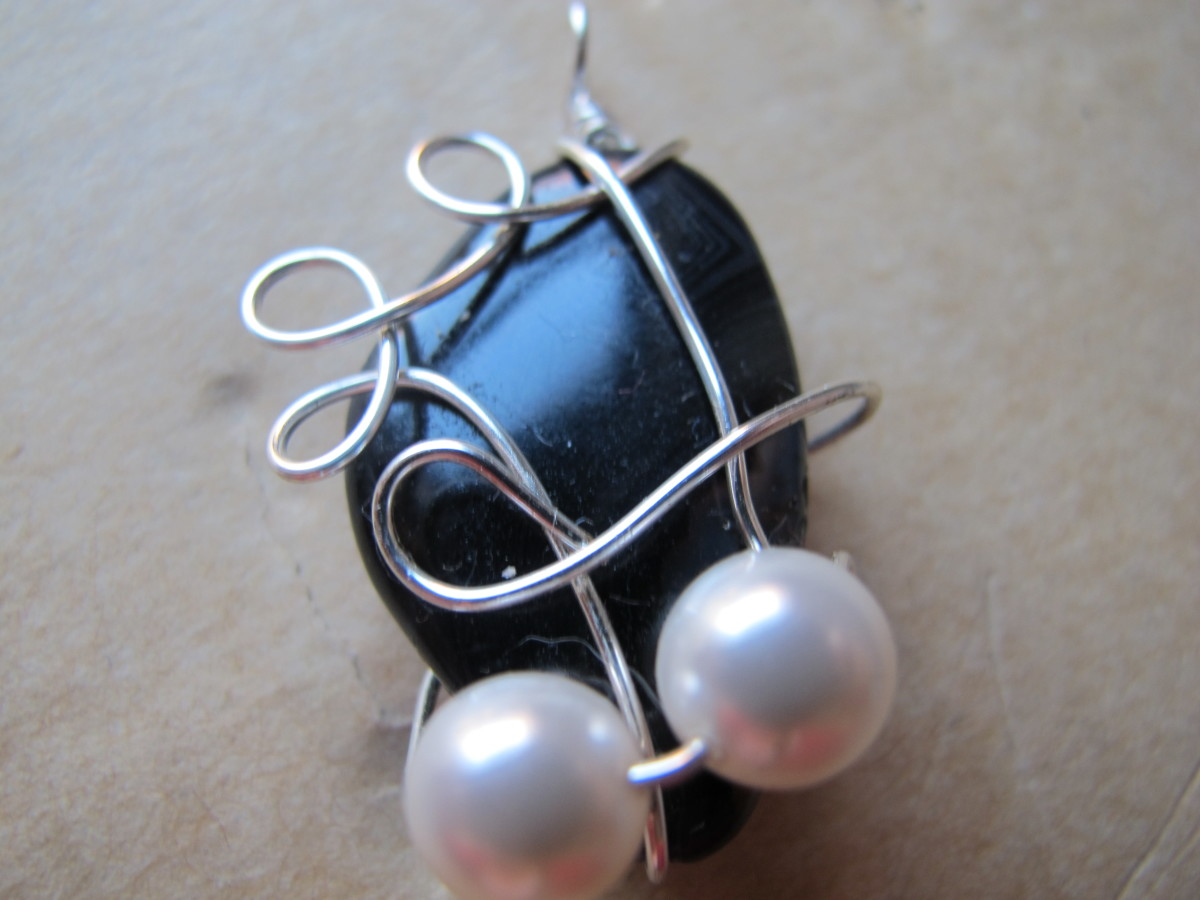 Black marble with silver wire wrap and pearls