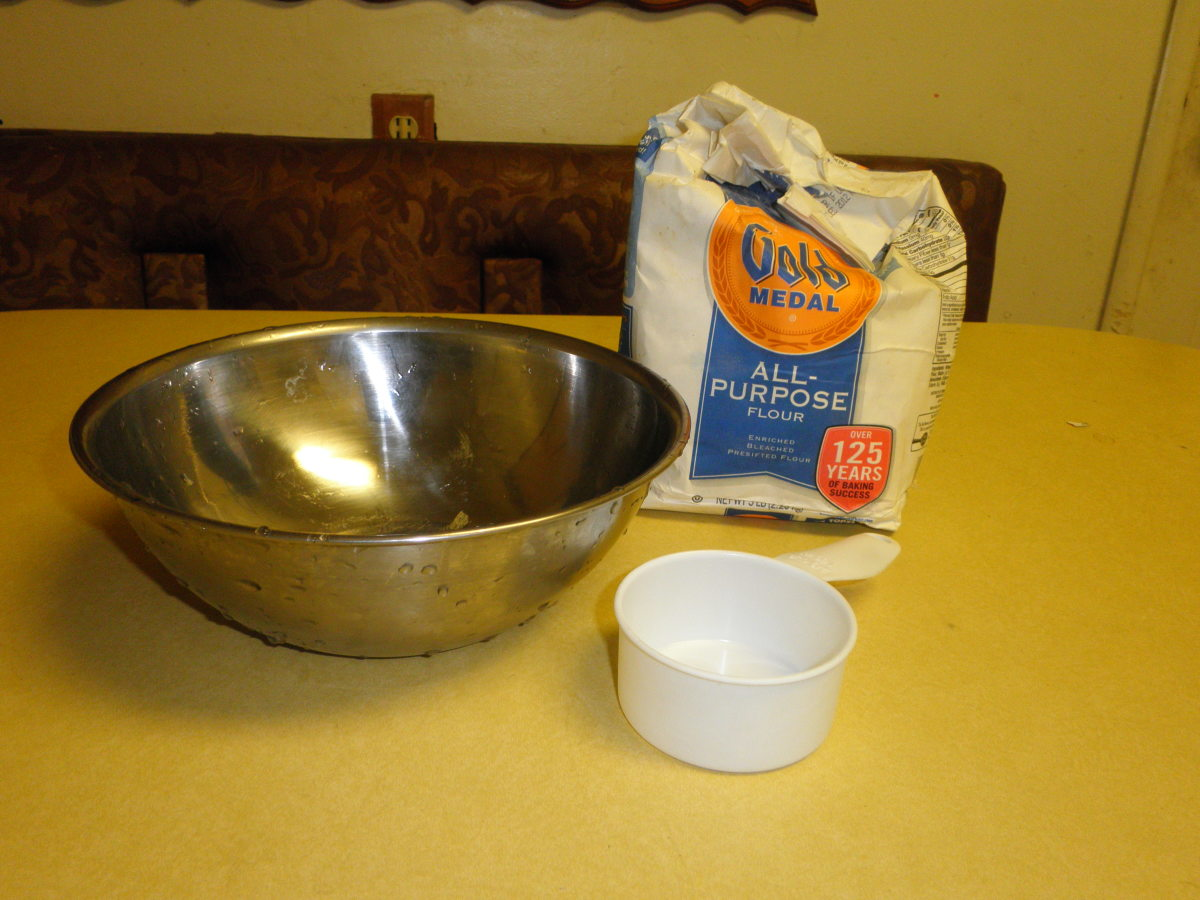 Prepare your flour mixture for the paper mache glue with flour,water and a mixing bowl.