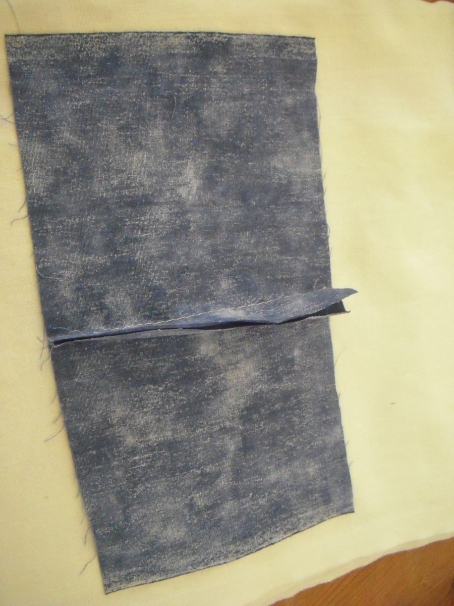 Place your fabric right-side down, seam allowance up, on your ironing surface