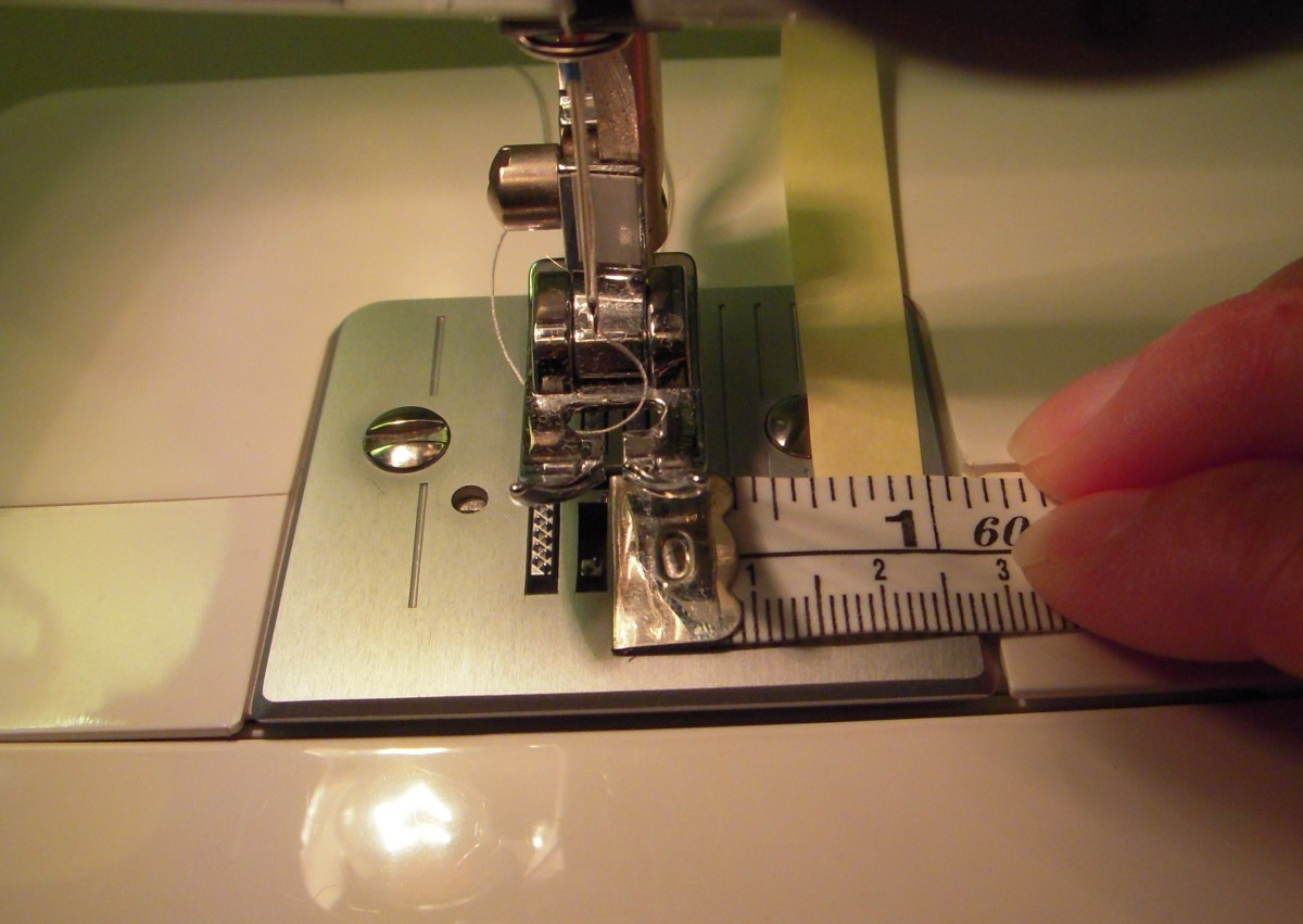"""Measure from center needle position to find the footplate marking that corresponds to the 5/8"""" seam allowance. You can put masking tape or other colorful reminder onto the footplate along the 5/8"""" mark to act as a reminder."""