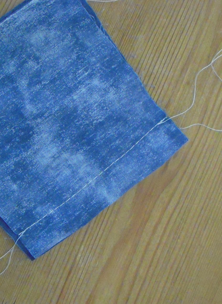"""This shows what a seam looks like after it is sewn. It uses reversed stitches at each end to """"lock"""" the seam. It has a 5/8"""" seam allowance. Now it is ready to be pressed open."""