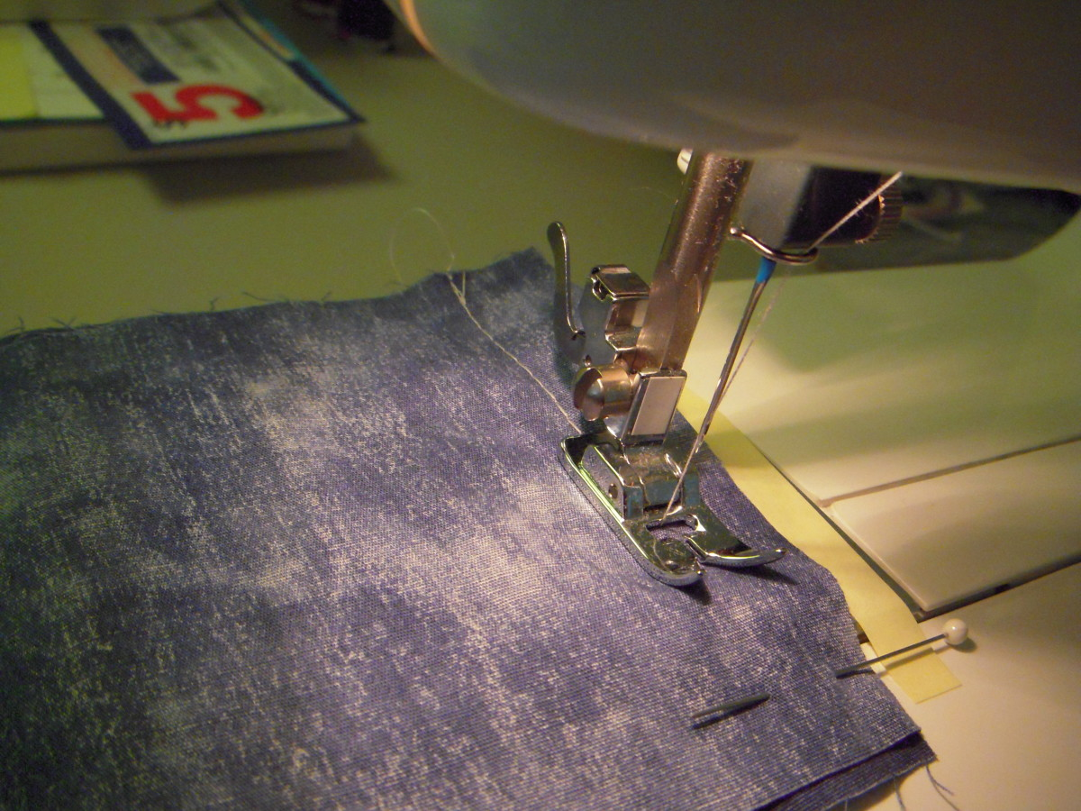 Sew the seam, guide with your left hand, but remember that the feed plate will push your fabric in the right direction (from front to back.)