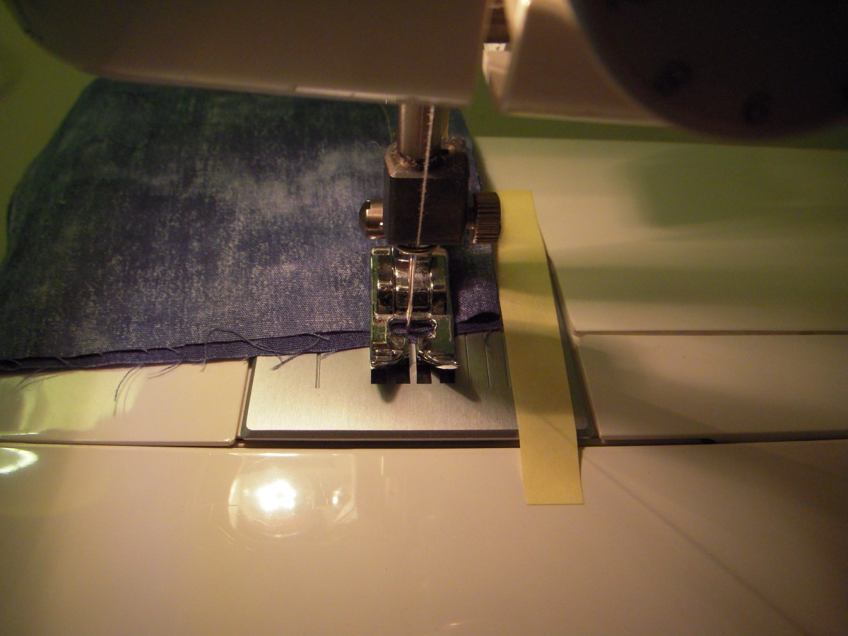 At the end of the seam, put the machine in reverse and sew a couple of stitches to lock the end of the seam.