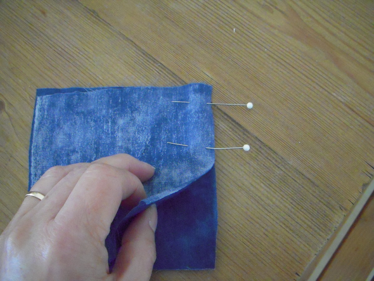 Line up fabric edges and pin perpendicular to the seam you will sew.