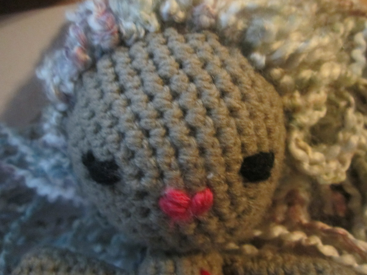 I think sewing down the hair with the skintone yarn made it really look like the hair was growing from the head!
