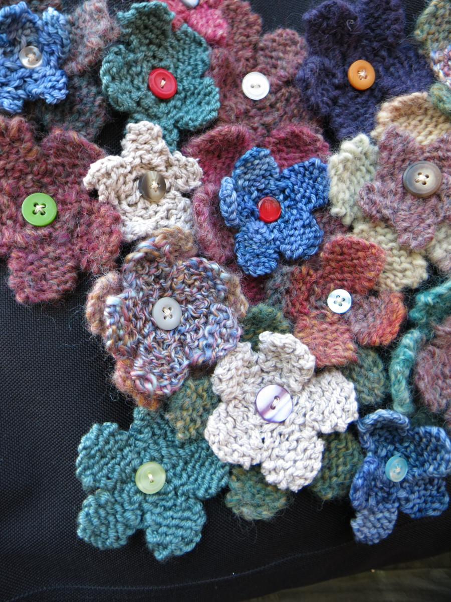 close up of button centers on knitted flowers