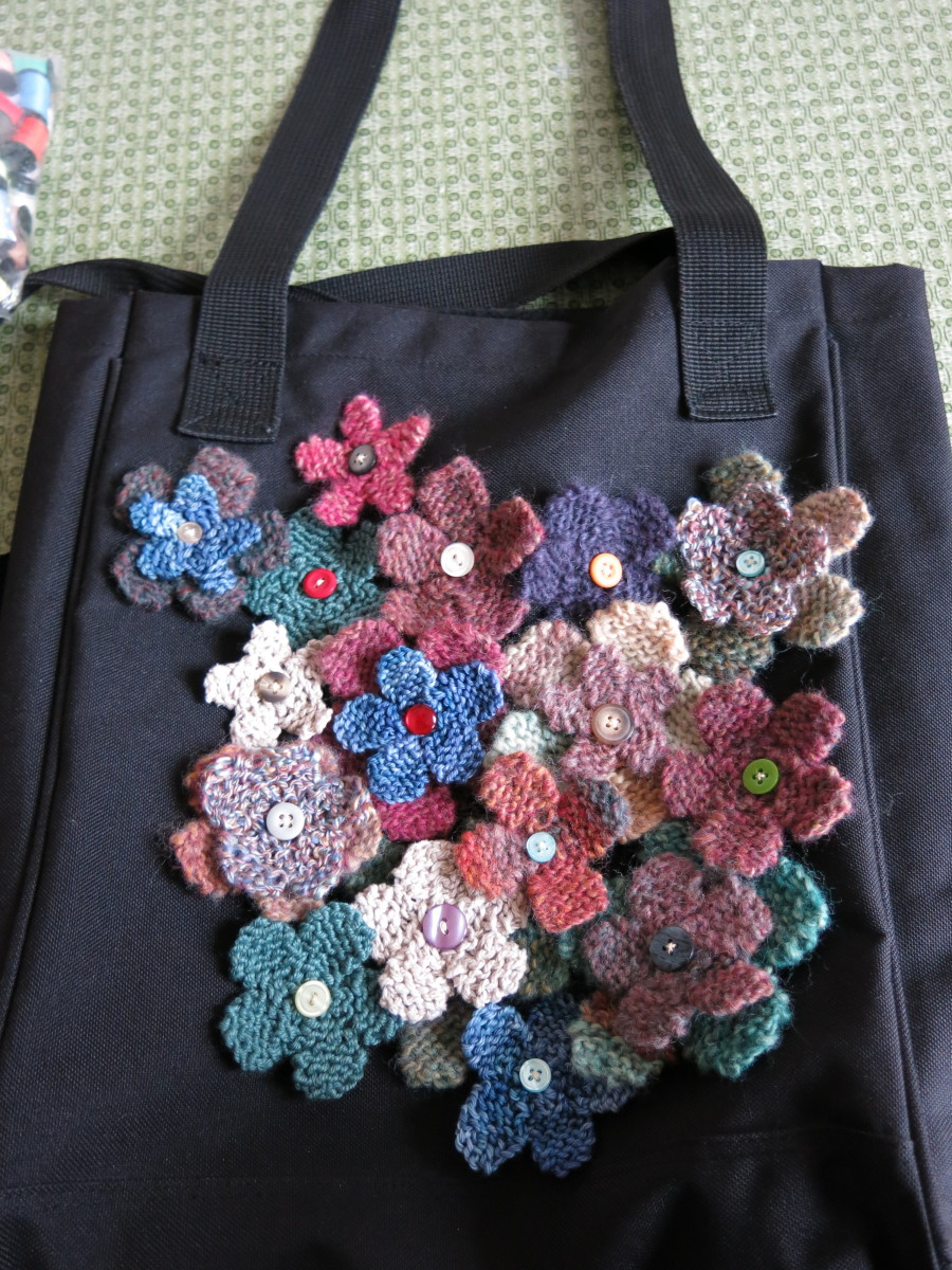 laying out your knitted flowers on your tote bag