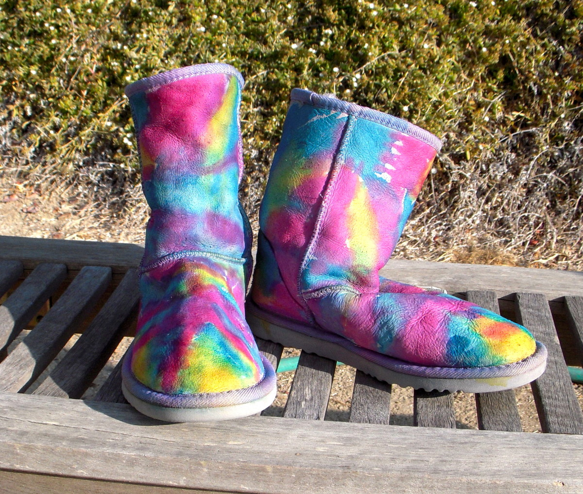 It takes several hours in the sun to dry wet Uggs. They can get moldy if you don't dry them quickly enough! Try a fan, keep blotting with a towel to get out excess water.