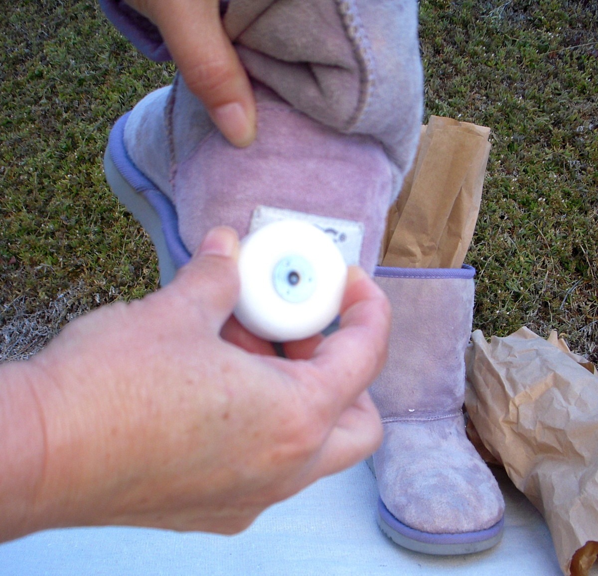 Rub wax over back labels on boots so they don't take up too much dye. I used an old votive candle.