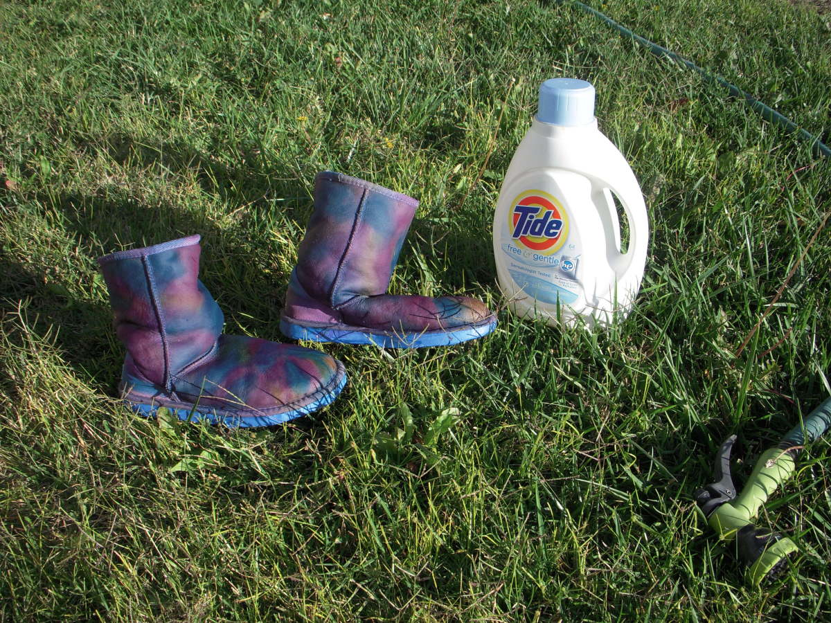 Wash the outsides of the boots with a little detergent and then rinse very well - inside and out - until the water runs clear. I used a garden hose.