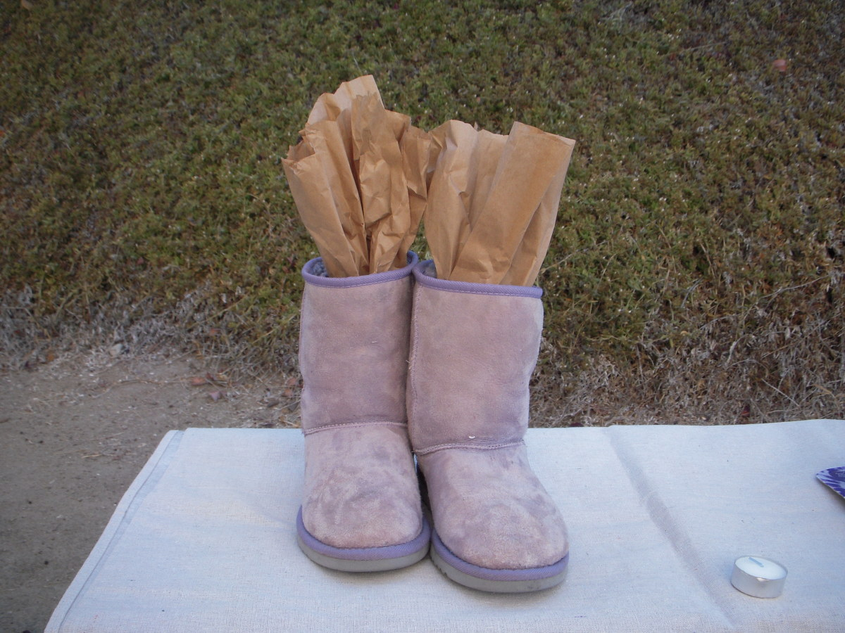 Cut craft paper and fit into boots to keep them from flopping while you work.