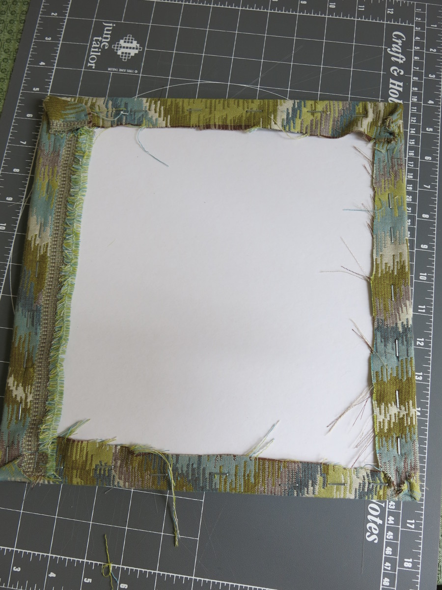 staple your fabric on all sides, making sure that it looks smooth and tight from the front of your bulletin board