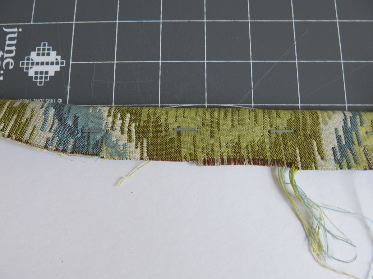 decorating your cork board by adding fabric