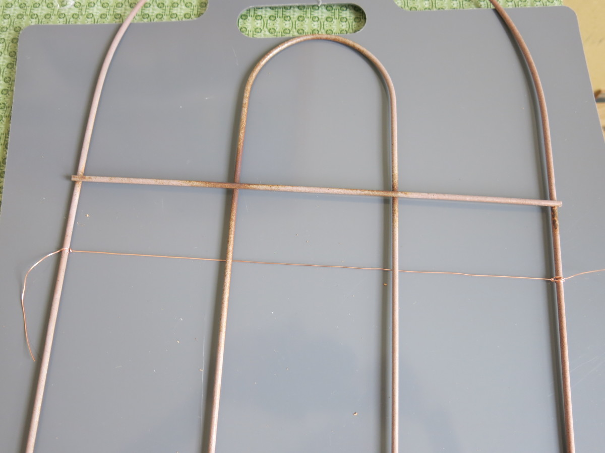 attaching wire to my fence piece to use it as a bulletin board or jewelry organizer