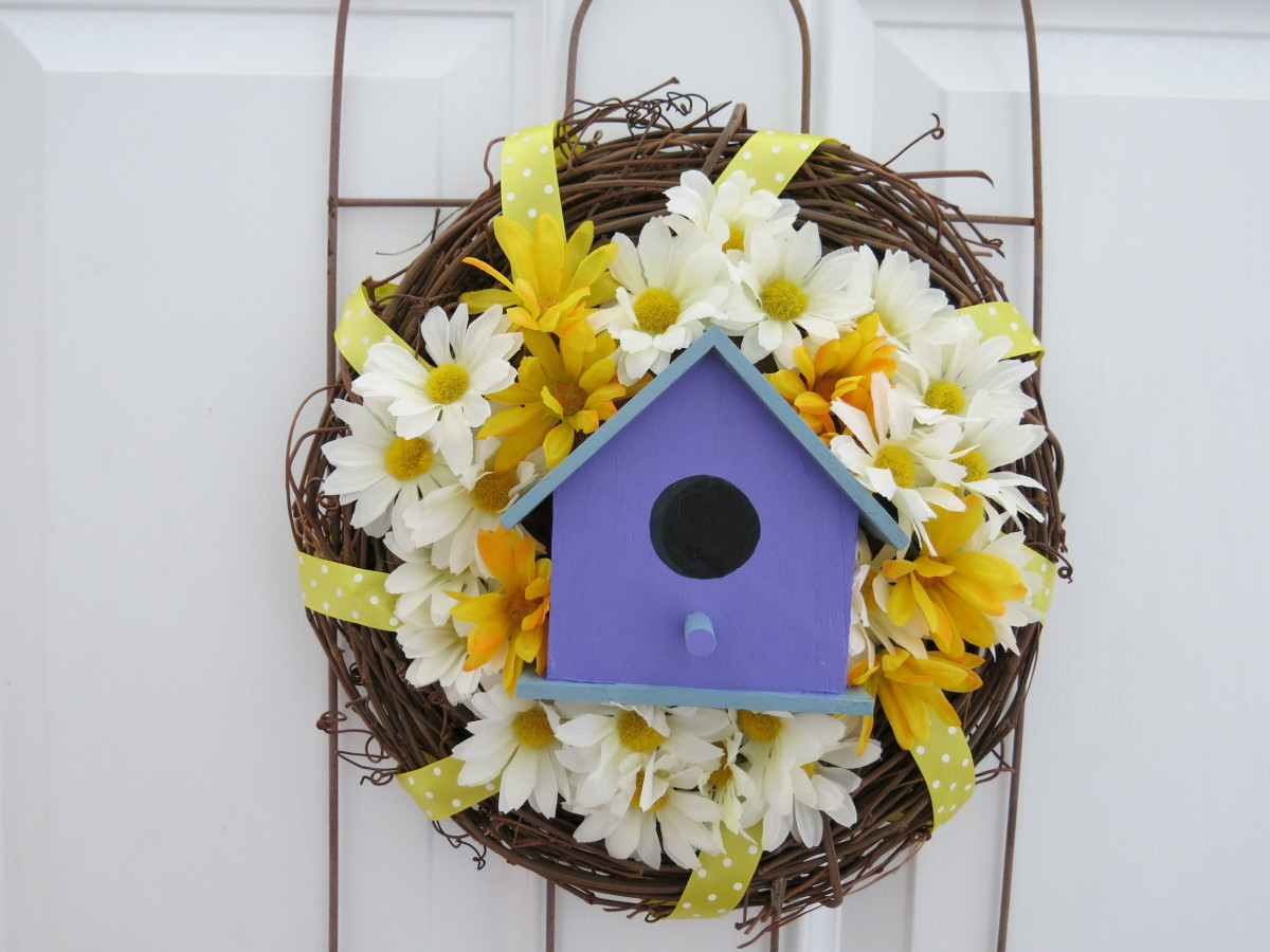 fill in around your bird house with artificial flowers to finish your decorative wreath
