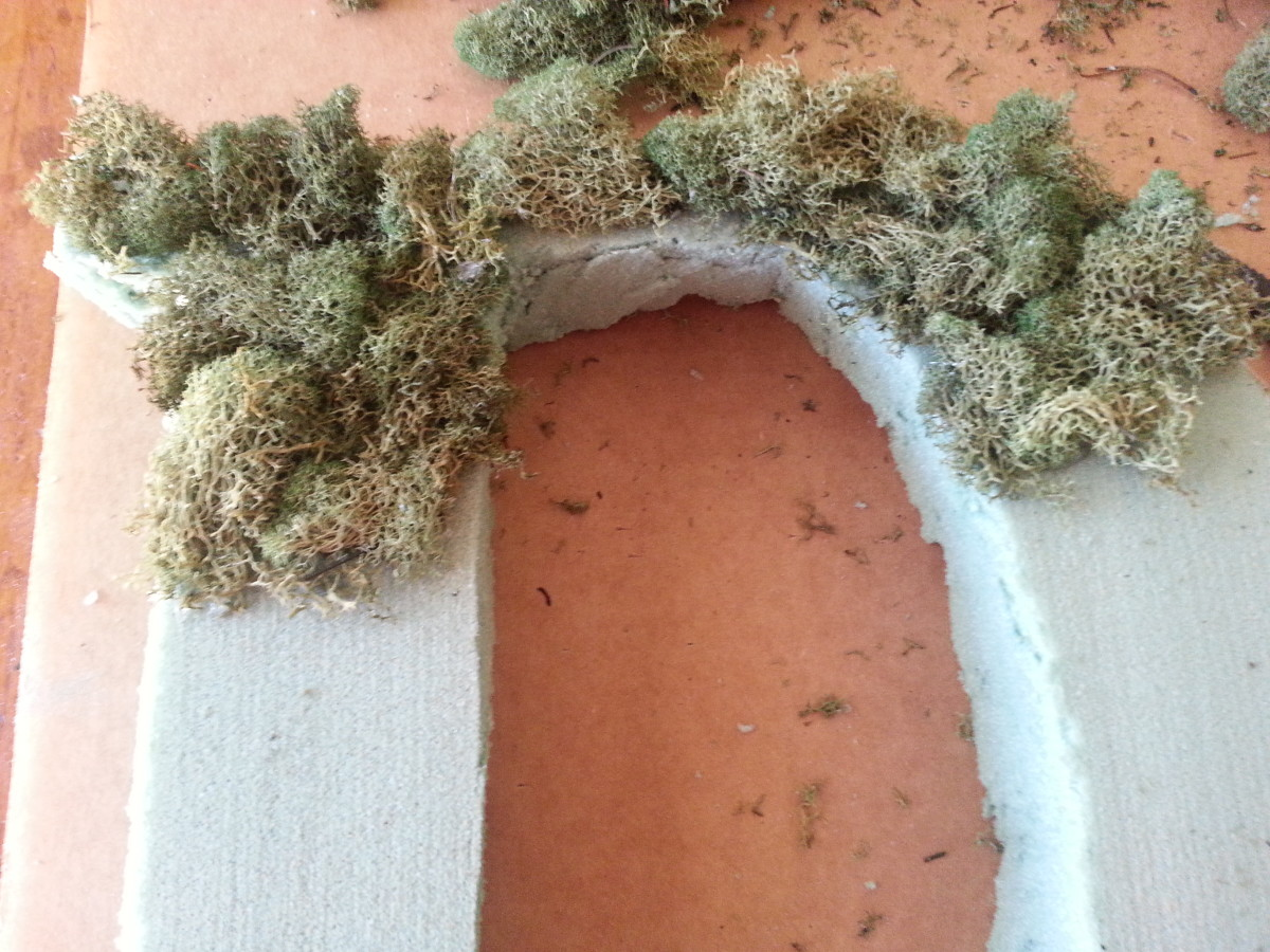 Slowly covering the Styrofoam letter with moss.  It looks pretty rough in the beginning, but do not lose heart, for it will shape up nicely.