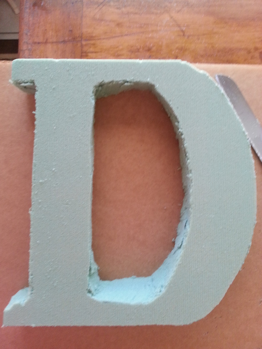 Cutting out the Styrofoam letter