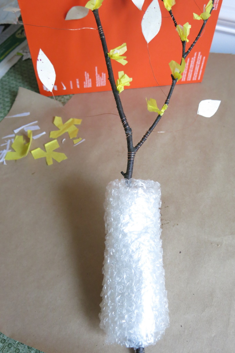Wrap the base of your branch with bubble wrap so it will stand up in a vase