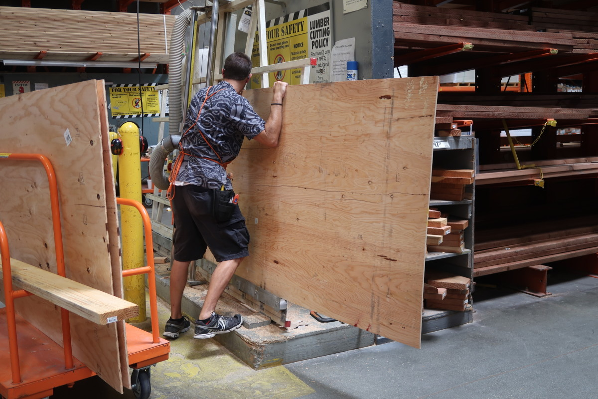 Have the associate cut the wood piece into smaller pieces.