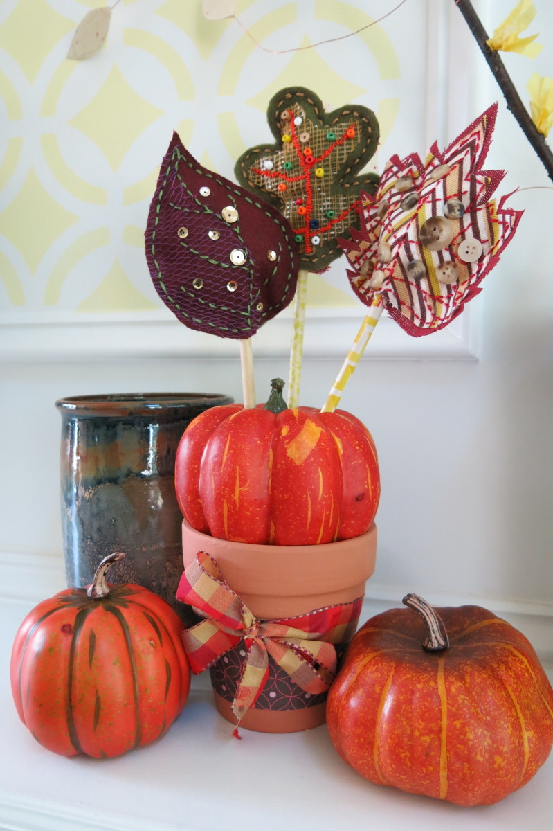 Display your scrap fabric leaves using a real or artificial pumpkin as a stand.