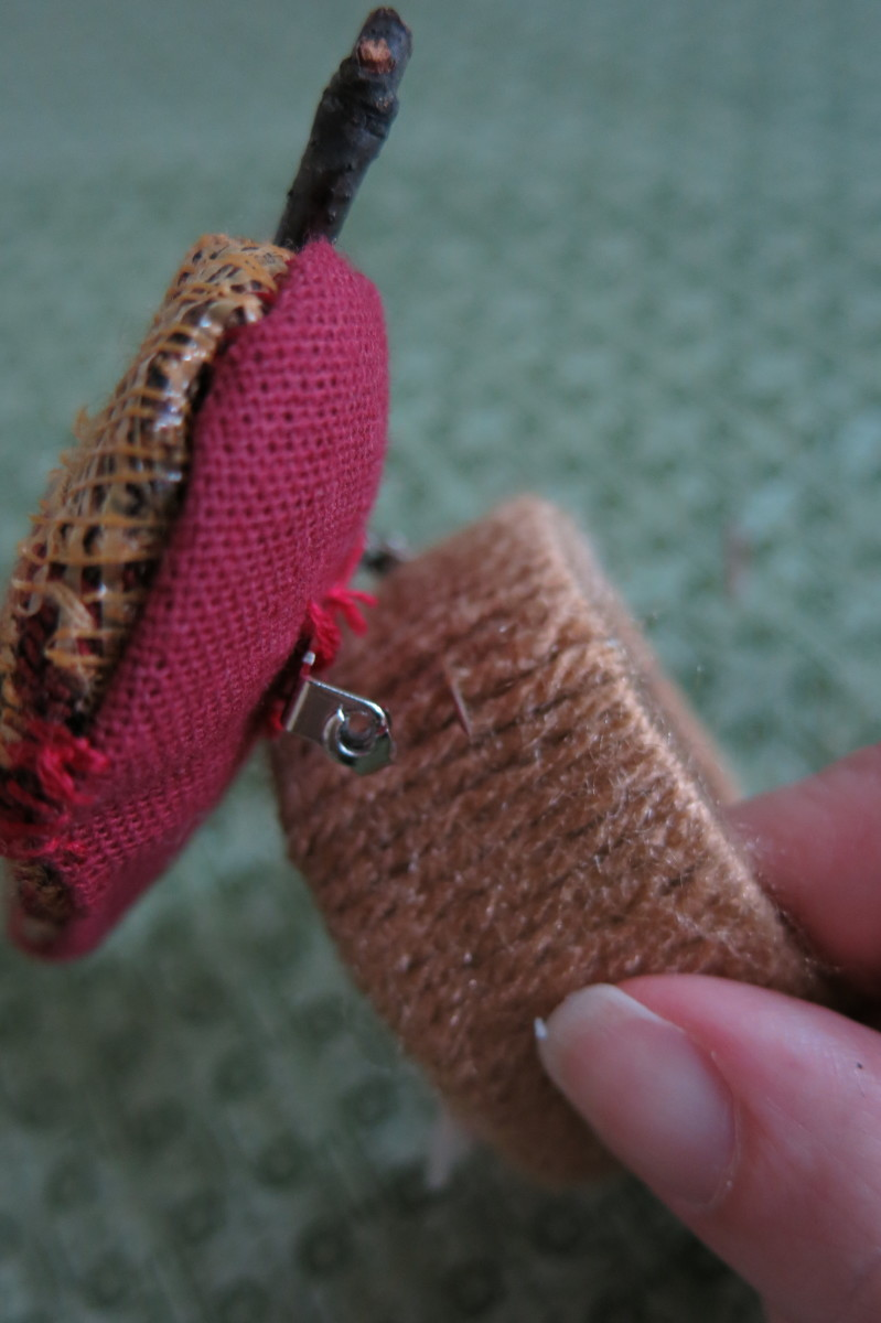 Attaching your scrap fabric acorn to your napkin ring.