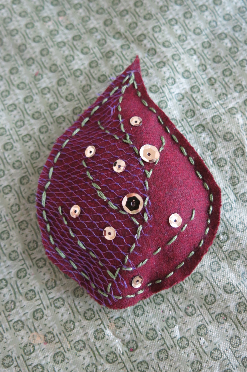Fill and decorate your scrap fabric leaf with beads, buttons, or sequin.