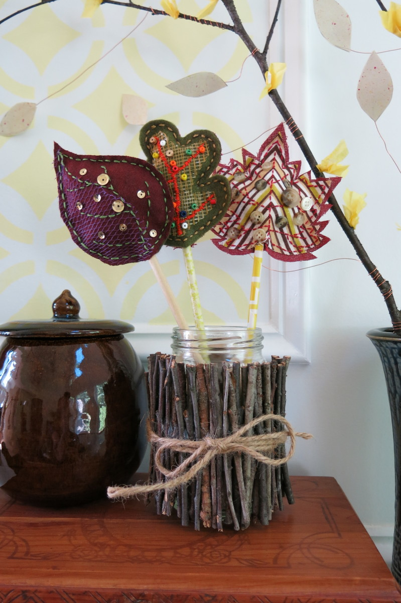 Use an empty jar wrapped with twigs to display your scrap fabric fall leaves