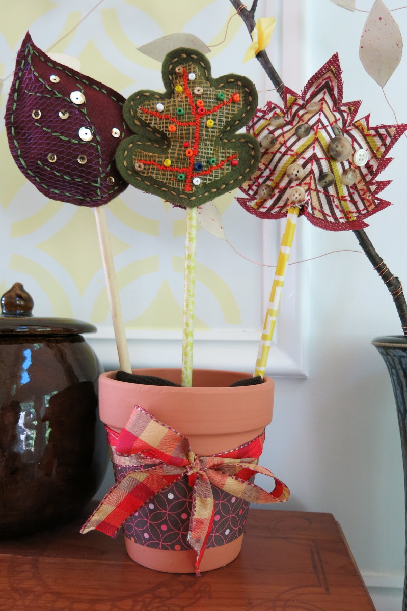 Plant the stems of your scrap fabric fall leaves in a small ceramic pot.