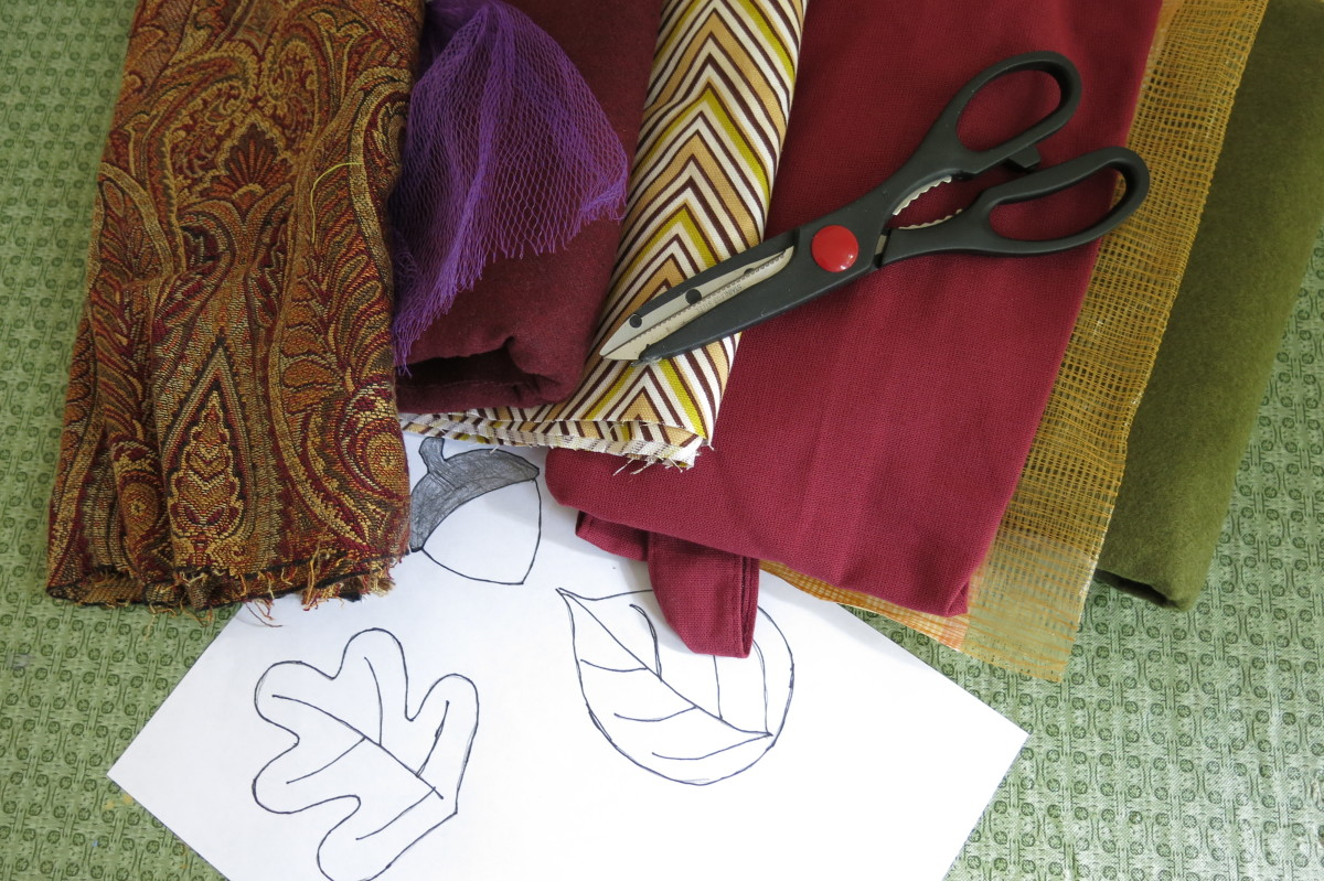 Materials for making scrap fabric fall leaves and cute little acorn