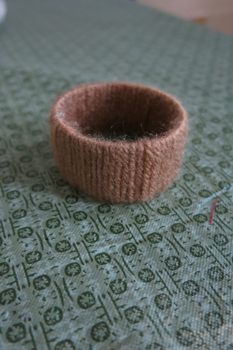 You can wrap a cardboard ring with yarn or twine to make a napkin ring.