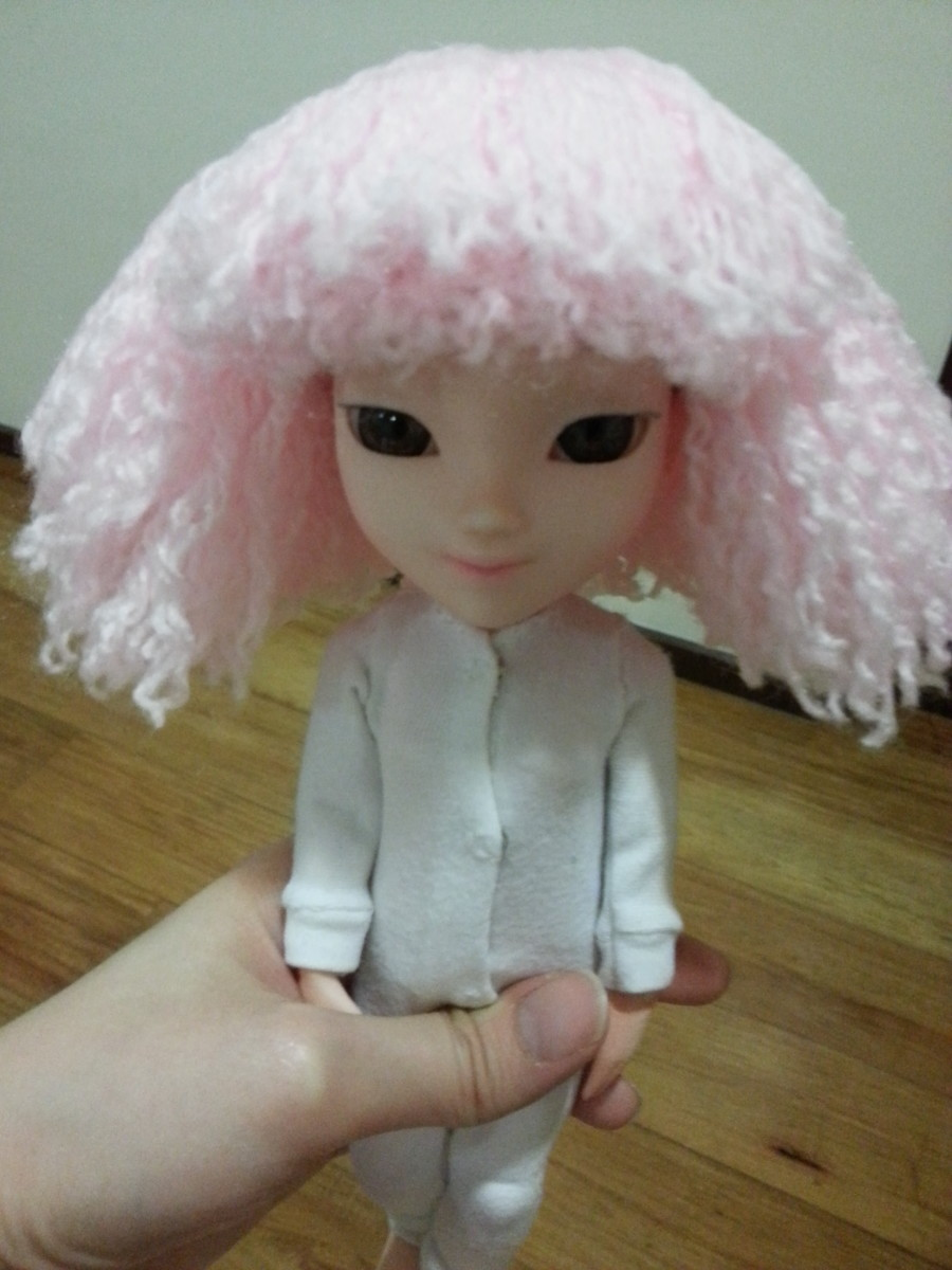 Front view of the wig once all the yarn is placed.