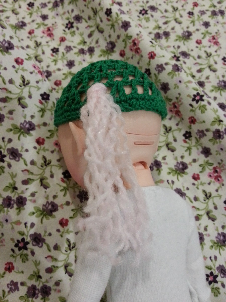 One bunch of yarn tied on to the wig cap.