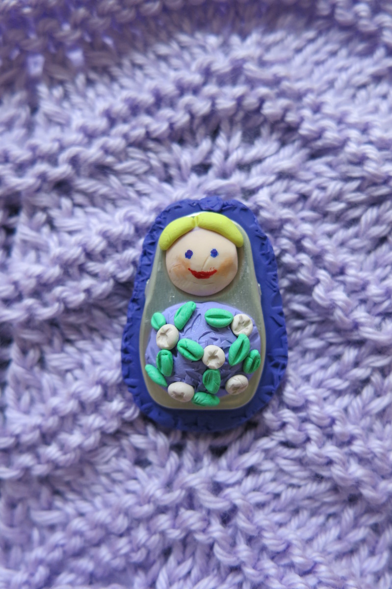 Your Matryoshka style polymer clay dolls can also be used to create a beautiful pin or brooch.