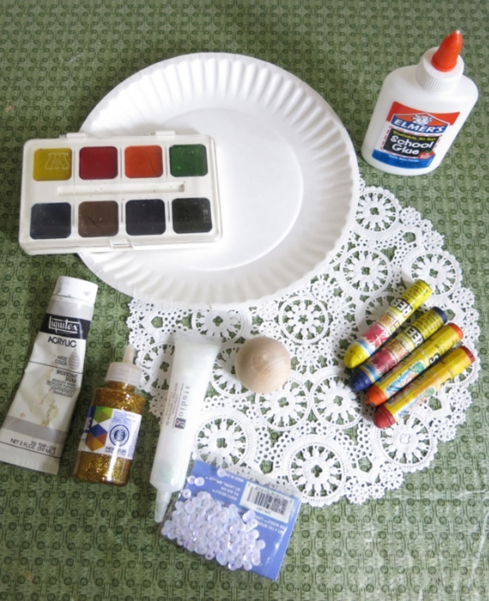 Materials for making a paper plate angel