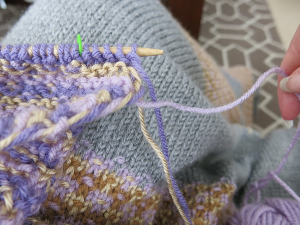 Bring your working yarn out and around the other colors to create a twist of the yarn up the edge of your blanket.