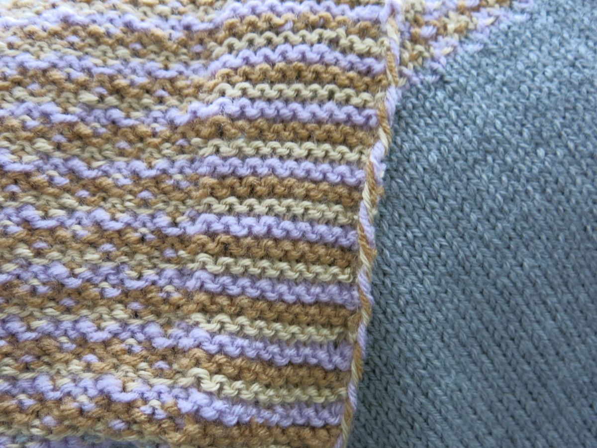 The twisted yarn sewn to the backside of the blanket..