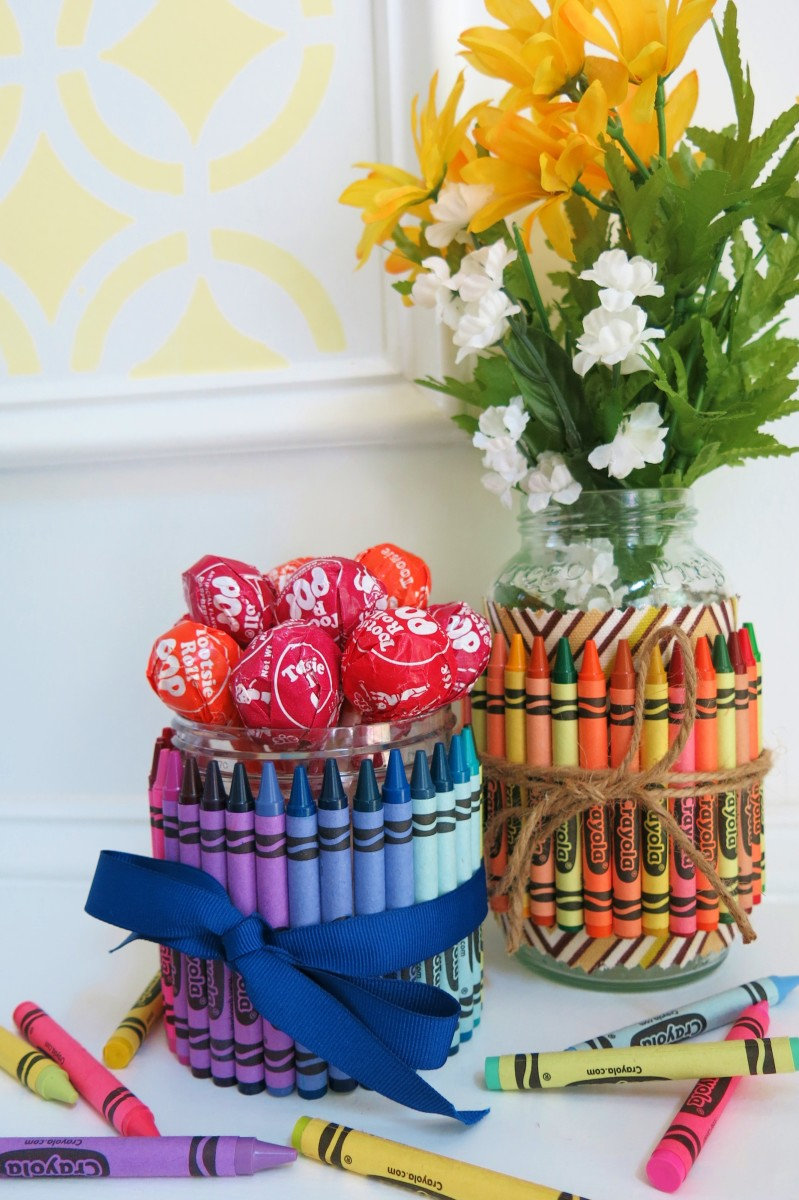 These crayon covered jars can be filled with flowers, candy, or art supplies to make the perfect gift or decoration.