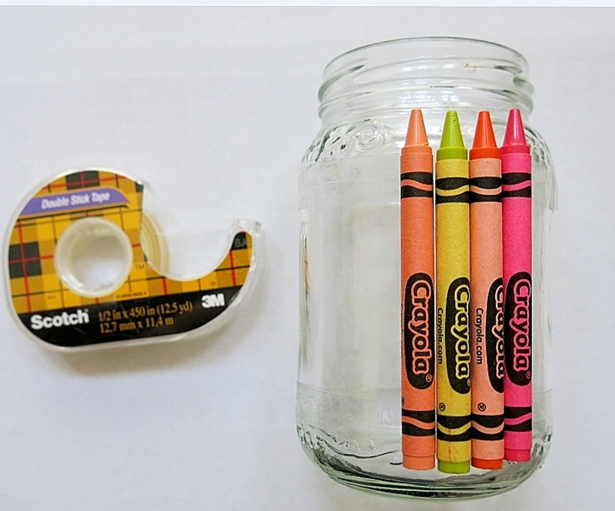 You can use double-stick tape to adhere crayons to jars